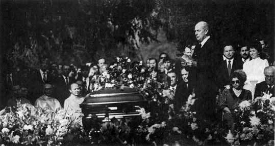 Hoeh officiates at Armstrong's funeral.